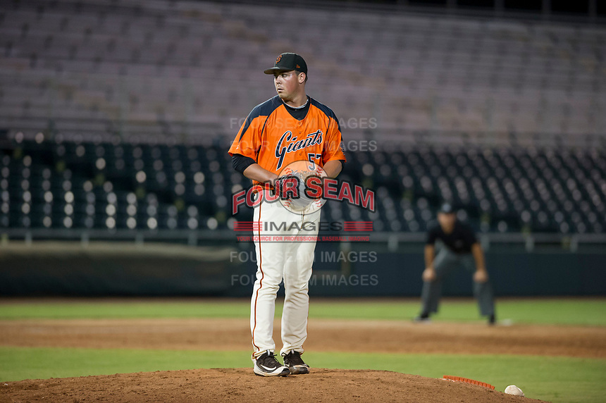 AZL Giants relief pitcher John Gavin (57) prepares to deliver a pitch to the plate against the AZL Cubs on September 5, 2017 at Scottsdale Stadium in Scottsdale, Arizona. AZL Cubs defeated the AZL Giants 10-4 to take a 1-0 lead in the Arizona League Championship Series. (Zachary Lucy/Four Seam Images)