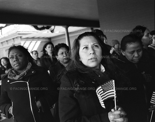 Oyster Bay, New York<br /> November 28, 2010<br /> <br /> Recent immigrants from across the globe, representing 28 countries, become American citizens at a naturalization ceremony held by the Department of Homeland Security on the porch of Teddy Roosevelt's home on Sagmore Hill in Long Island. When Roosevelt was President he sought to severely limit the number of immigrants arriving from Southern and Eastern Europe, and instituted quotas to make sure that Northern Europeans received citzenship.