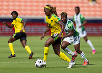 HOUSTON, TX - JUNE 10: Cheyna Matthews #20 of Jamaica dribbles the ball during a game between Nigeria and Jamaica at BBVA Stadium on June 10, 2021 in Houston, Texas.