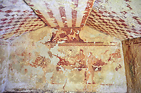 "Underground Etruscan tomb Known as ""Tomba della Caccia al Cervo"" A single chamber with double sloping ceiling. On the back wall is painted a banquet scene with three couples lying on beds (Klinai). On the dide walls are dancers and musicians. Circa 450 BC. Excavated 1960 , Etruscan Necropolis of Monterozzi, Monte del Calvario, Tarquinia, Italy. A UNESCO World Heritage Site."