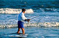 Senior man surf fishing.