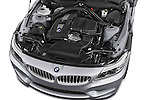 Car Stock 2014 BMW Z4 sDrive35i Lounge 2 Door Convertible 2WD Engine high angle detail view