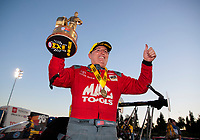 Nov 17, 2019; Pomona, CA, USA; NHRA top fuel driver Doug Kalitta celebrates after winning the Auto Club Finals at Auto Club Raceway at Pomona. Mandatory Credit: Mark J. Rebilas-USA TODAY Sports
