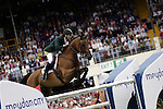 August 07, 2009: Ireland's Denis Lynch in action aboard Lantinus. Meydan FEI Nations Cup. Failte Ireland Horse Show. The RDS, Dublin, Ireland.