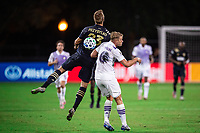 LAKE BUENA VISTA, FL - JULY 20: Kacper Przybylko #23 of the Philadelphia Union and Robin Jansson #6 of Orlando City SC battle for the ball during a game between Orlando City SC and Philadelphia Union at Wide World of Sports on July 20, 2020 in Lake Buena Vista, Florida.