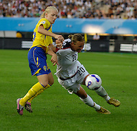 U.S. forward (20) Abby Wambach tries to turn the corner on a Swedish defender. The United States (USA) defeated Sweden (SWE) 2-0 during a FIFA Women's World Cup China 2007 opening round Group B match at Chengdu Sports Center Stadium, Chengdu, China, on September 14, 2007.