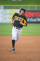 Gary Brown (15) of the Salt Lake Bees in action against the Tacoma Rainiers in Pacific Coast League action at Smith's Ballpark on May 7, 2015 in Salt Lake City, Utah.  (Stephen Smith/Four Seam Images)