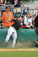 Miami Marlins third baseman Ty Wigginton (8) goes into the stands to try and catch a foul ball during a spring training game against the Houston Astros on March 21, 2014 at Osceola County Stadium in Kissimmee, Florida.  Miami defeated Houston 7-2.  (Mike Janes/Four Seam Images)