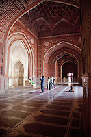 Agra, India.  Taj Mahal Mosque.  Worshippers at Mid-day Prayer.  Little Girl in Rear.