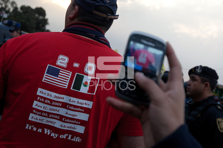 USA fan Doug Morales has a photo taken of his shirt after arriving for the USA vs. Mexico World Cup Qualifier at Azteca stadium in Mexico City, Mexico on March 26, 2013.