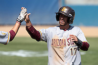 Deven Marrero #17 of the Arizona State Sun Devils is greeted after scoring a run during a game against the Long Beach State Dirtbags at Blair Field on March 11, 2012 in Long Beach,California. Arizona State defeated Long Beach State 6-1.(Larry Goren/Four Seam Images)