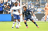 KANSAS CITY, KS - MAY 16: Cristian Dajome #11 Vancouver Whitecaps with the ball during a game between Vancouver Whitecaps and Sporting Kansas City at Children's Mercy Park on May 16, 2021 in Kansas City, Kansas.