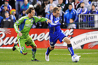 Michael Harrington (blue), Roger Levesque...Kansas City Wizards were defeated 3-2 by Seattle Sounders at Community America Ballpark, Kansas City, Kansas.