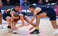 NZ Men's Jake Schuster (left) and Timmy Apisai try to get the ball off Monica Faulkner during the Cadbury Netball Series match between NZ Silver Ferns and NZ Men at the Fly Palmy Arena in Palmerston North, New Zealand on Thursday, 22 October 2020. Photo: Dave Lintott / lintottphoto.co.nz