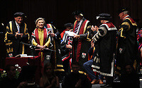 Pictured: Professor Richard B Davies (L), Vice Chancellor for Swansea University (L) and colleagues award Hillary Clinton hith an honorary degree at Swansea University Bay Campus. Saturday 14 October 2017<br />Re: Hillary Clinton, the former US secretary of state and 2016 American presidential candidate will be presented with an honorary doctorate during a ceremony at Swansea University's Bay Campus in Wales, UK, to recognise her commitment to promoting the rights of families and children around the world.<br />Mrs Clinton's great grandparents were from south Wales.