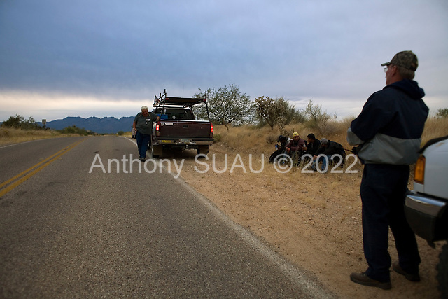 Three Points, Arizona.USA.October 23, 2006..Arizona resident David Jones (handle- Pineapple6), and Ed Hart from Alabama, are members of the Minuteman Civil Defense Corps of Arizona. Near the King Anvil Ranch where they stop 4 Mexicans who have crossed the border illegal. They give the four water and hold until the Arizona border patrol arrives to detain them and send them back to Mexico....