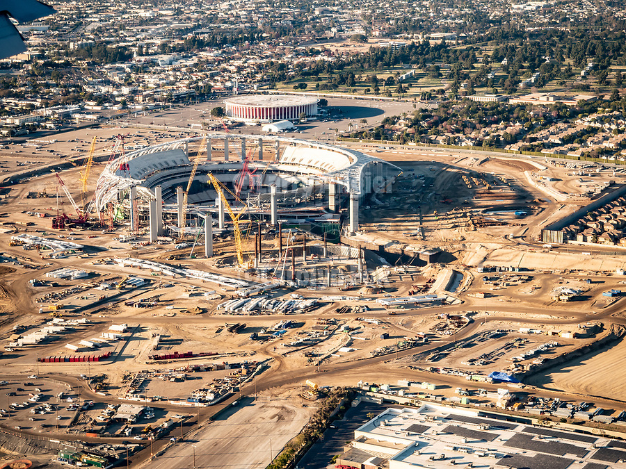 Los Angeles Rams, LA Stadium under construction and the LA Forum, Los Angeles, California, from a window seat on a United Airlines flight from Chicago to Los Angeles over America's Flyover County.