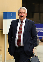Pictured: First minister for Wales Carwyn Jones rolls his eyes while arriving to comments shouted by anti-Hillary Clinton protesters at Swansea University Bay Campus. Saturday 14 October 2017<br /> Re: Hillary Clinton, the former US secretary of state and 2016 American presidential candidate will be presented with an honorary doctorate during a ceremony at Swansea University's Bay Campus in Wales, UK, to recognise her commitment to promoting the rights of families and children around the world.<br /> Mrs Clinton's great grandparents were from south Wales.