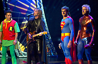 July 10, Montreal, Quebec, Canada<br /> <br /> Quebec musician Daniel Boucher, dressed as BATMAN, interpret a song while fellow musician Eric Lapointe, dressed as ROBIN (L),  and Olypmpic skating champion Marc Gagnon, dressed as SPIDERMAN (R) join <br /> Stand up comic Patrick Huard, dressed as SUPERMAN (M-R), for  a sketch on the opening night Gala of the 20th Juste Pour Rire Festival.<br /> <br /> <br /> <br /> Mandatory Credit: Photo by Pierre Roussel- Images Distribution. (©) Copyright 2002 by Pierre Roussel <br /> <br /> NOTE : <br />  Nikon D-1 jpeg opened with Qimage icc profile, saved in Adobe 1998 RGB<br /> .Uncompressed  Original  size  file availble on request.