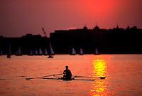 Sculling on the Charles River at sunset. Boston-Cambridge line, Massachusetts.