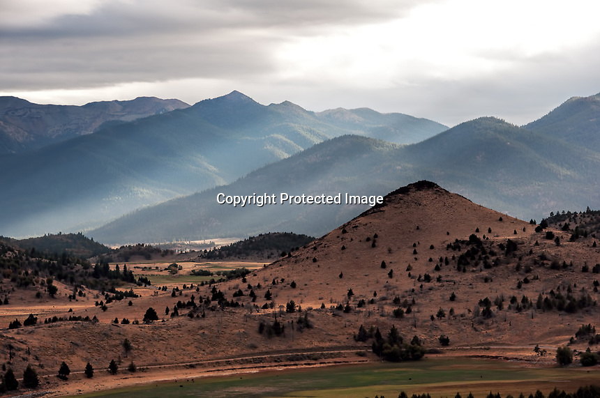 The sun peeks through the clouds near Mount Shasta in the Fall, California, USA.
