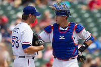 Round Rock Express catcher Eli Whiteside #18 talks with pitcher Neil Cotts #56 during the Pacific Coast League baseball game against the New Orleans Zephyrs in the on April 21, 2013 at the Dell Diamond in Round Rock, Texas. Round Rock defeated New Orleans 7-1. (Andrew Woolley/Four Seam Images).