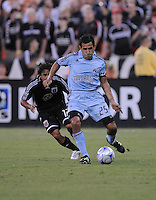 Colorado Rapids midfielder Pablo Mastroeni (25) makes a pass and chase from behind by DC United midfielder Ivan Guerrero (12), DC United defeated The Colorado Rapids  3-0, Saturday August 23, 2008 at RFK Stadium.