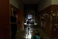 """Das ehemalige St. Josefsheim Waldniel-Hostert, Fuehrung durch das Heim mit der Kentschool Security Group, [das Josefsheim ist ein ehemaliges Franziskaner-Heim fuer Kinder mit Behinderung, nach 1937 war es die Kinderfachabteilung der Provinzial Heil- und Pflegeanstalt, in dieser Zeit wurden ca. 100 Kindern mit Behinderung durch die Nationalsozialisten ermordet, von 1963 bis 1991 britische Kent-School], heute leerstehende Ruine, [Treffpunkt fuer """"Geisterjaeger""""], Nacht, Nachtaufnahme, unheimlich, gruselig, lost place, lost places, moderne Ruine, Grundstueck, innen, Fotograf, Photographen, Verfall, verfallen, Gedenkstaette, Euthanasie, Kindereuthanasie, Naziverbrechen, Verbrechen, Behinderung, Nationalsozialismus, Nazi-Zeit, Drittes Reich, Geschichte, Historie, Josefs-Heim, Europa, Deutschland, Nordrhein-Westfalen, Viersen, Schwalmtal, 08/2013<br /> <br /> Engl.: Europe, Germany, North Rhine-Westphalia, Viersen, Schwalmtal, former St. Josefsheim Waldniel-Hostert, guided tour through the home with the Kentschool Security Group, building, interior view, ruin, night, memorial site, euthanasia, mercy killing, crime, disability, National Socialism, Third Reich, history, the Josefsheim is a former home managed by Franciscan monks for disabled children, after 1937 the National Socialists killed approx. 100 disabled children there, from 1963 - 1991 British Kent-School, August 2013"""