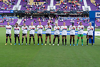 ORLANDO, FL - FEBRUARY 21: The USWNT stands during the national anthem before a game between Brazil and USWNT at Exploria Stadium on February 21, 2021 in Orlando, Florida.