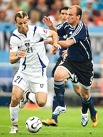 Danijel Ljuboja (21) of Serbia & Montenegro in action against Esteban Cambiasso of Argentina Argentina defeated Serbia and Montenegro 6-0 in their FIFA World Cup Group C match at FIFA World Cup Stadium, Gelsenkirchen, Germany, June 16, 2006.