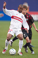 Chicago midfielder Andy Williams is marked by Mike Magee of the MetroStars. Williams had three assists as the Chicago Fire defeated the NY/NJ MetroStars 3-2 on 6/14/03 at Giant's Stadium, NJ..