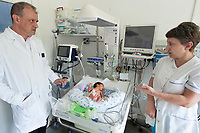 """Nagorno-Karabakh, also known as Artsakh, is a landlocked region in the South Caucasus. Stepanakert is the capital and the largest city of the Republic of Artsakh (better known as Nagorno-Karabakh). Hospital. """"Mother and Children Healthcare Center"""". Maternity ward. The doctor Vartekes Osipov (L) talks to a nurse (R). Premature baby girl. Nagorno-Karabakh is a disputed territory, internationally recognized as part of Azerbaijan, but most of the region is governed by the Republic of Artsakh (formerly named Nagorno-Karabakh Republic), a de facto independent state with Armenian ethnic population.  Since 1994, regular peace talks between Armenia and Azerbaijan mediated by the OSCE Minsk Group have failed to result in a peace treaty.  7.10.2019 © 2019 Didier Ruef"""