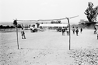 Rwanda. Gitagata. Prison for 152 children, aged 4 to 14, all convicted for active involvement (murder) in the 1994 rwandese genocide. Reeducation camp for minors. A truck from the non-governmental organization (NGO) Médecins Sans Frontières (MSF) Belgium brings water to the jail. Football field. © 1995 Didier Ruef