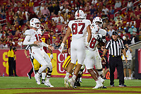 LOS ANGELES, CA - SEPTEMBER 11: Tanner McKee #18, Myles Hinton #78, Bradley Archer #87 and Nathaniel Peat #8 of the Stanford Cardinal celebrate after an 87 yard touchdown run by Nathaniel Peat during a game between University of Southern California and Stanford Football at Los Angeles Memorial Coliseum on September 11, 2021 in Los Angeles, California.