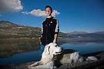 Greek student Konstantinos Vartziotis,18, with his dog by the Ioannina lake.
