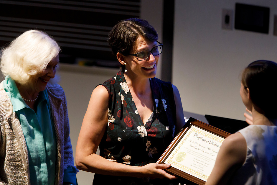Sonja Inglefield receives a certificate of dedication from USA International Harp Competition Executive Director Erin Brooker-Miller, right, during the Composition Forum at the 11th USA International Harp Competition at Indiana University in Bloomington, Indiana on Monday, July 8, 2019. (Photo by James Brosher)