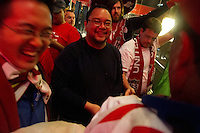 USA fans share a laugh after signing a Mexican flag at the Galeria Plaza hotel. The USA tied Mexico at their World Cup Qualifier at Azteca stadium in Mexico City, Mexico on March 26, 2013.
