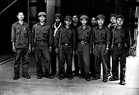 Khmer Rouge guards at the S-21 detention centre at Tuol Sleng, where over 16,000 inmates were killed between 1975 and 1979. The photograph was taken by the Khmer. The man fourth from left, Him Huy, later confessed to killing over 1,000 people.