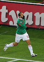 Cuauhtemco Blanco of Mexico celebrates scoring the second goal against France.