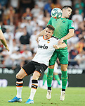Valencia CF's Kevin Gameiro (l) and Real Sociedad's Igor Zubeldia during La Liga match. August 17,2019. (ALTERPHOTOS/Acero)
