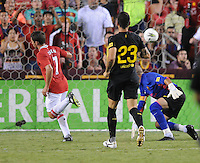 Manchester United forward Michael Owen (7) scores against FC Barcelona Victor Valdez (1) Manchester United defeated Barcelona FC 2-1 at FedEx Field in Landover, MD Saturday July 30, 2011.