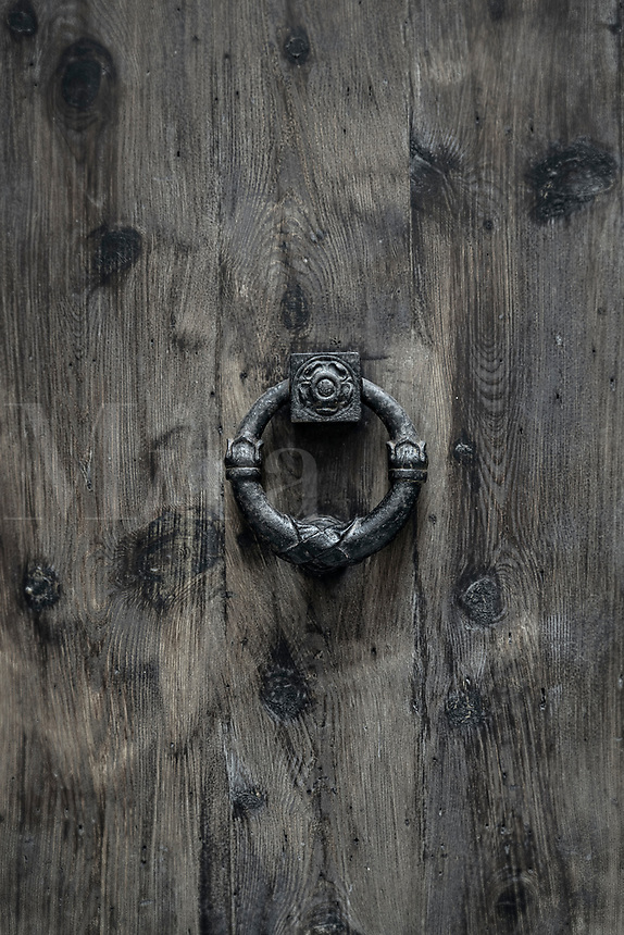 Rustic medieval door knock, Palma, Mallorca, Spain.