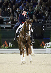 Laura Bechtolsheimer and Mistral Hojris of Great Britain perform their Freestyle Dressage in the Grand Prix Freestyle Dressage competition at the Alltech World Equestrian Games in Lexington, Kentucky.