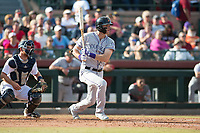 Salt River Rafters right fielder Sam Hilliard (14), of the Colorado Rockies organization, follows through on his swing in front of catcher Joe DeCarlo (4) during the Arizona Fall League Championship Game against the Peoria Javelinas at Scottsdale Stadium on November 17, 2018 in Scottsdale, Arizona. Peoria defeated Salt River 3-2 in 10 innings. (Zachary Lucy/Four Seam Images)