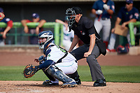 Lynchburg Hillcats catcher Logan Ice (20) and umpire Mike Snover await the pitch during the first game of a doubleheader against the Potomac Nationals on June 9, 2018 at Calvin Falwell Field in Lynchburg, Virginia.  Lynchburg defeated Potomac 5-3.  (Mike Janes/Four Seam Images)