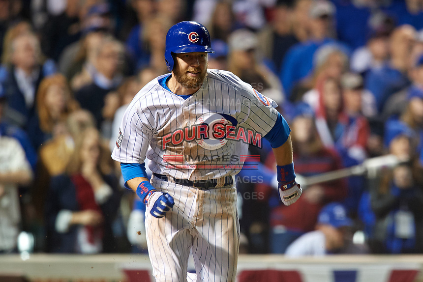 Chicago Cubs Ben Zobrist (18) runs to first base Game 3 of the Major League Baseball World Series against the Cleveland Indians on October 28, 2016 at Wrigley Field in Chicago, Illinois.  (Mike Janes/Four Seam Images)