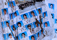 Pictures from a school year book covered in sand amongst the ruins at Minamisanriku, Myiagi, Japan. The fishing port of Minamisanriku, Miyagi, Japan was devastated by the tsunami where the popultion was reduced from 18,000 to about 8,000.<br /> <br /> Richard Jones  / Sinopix