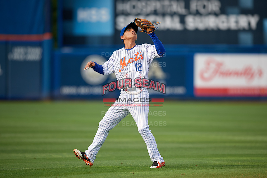 St. Lucie Mets shortstop Andres Gimenez (12) settles under a pop up during the first game of a doubleheader against the Charlotte Stone Crabs on April 24, 2018 at First Data Field in Port St. Lucie, Florida.  St. Lucie defeated Charlotte 5-3.  (Mike Janes/Four Seam Images)