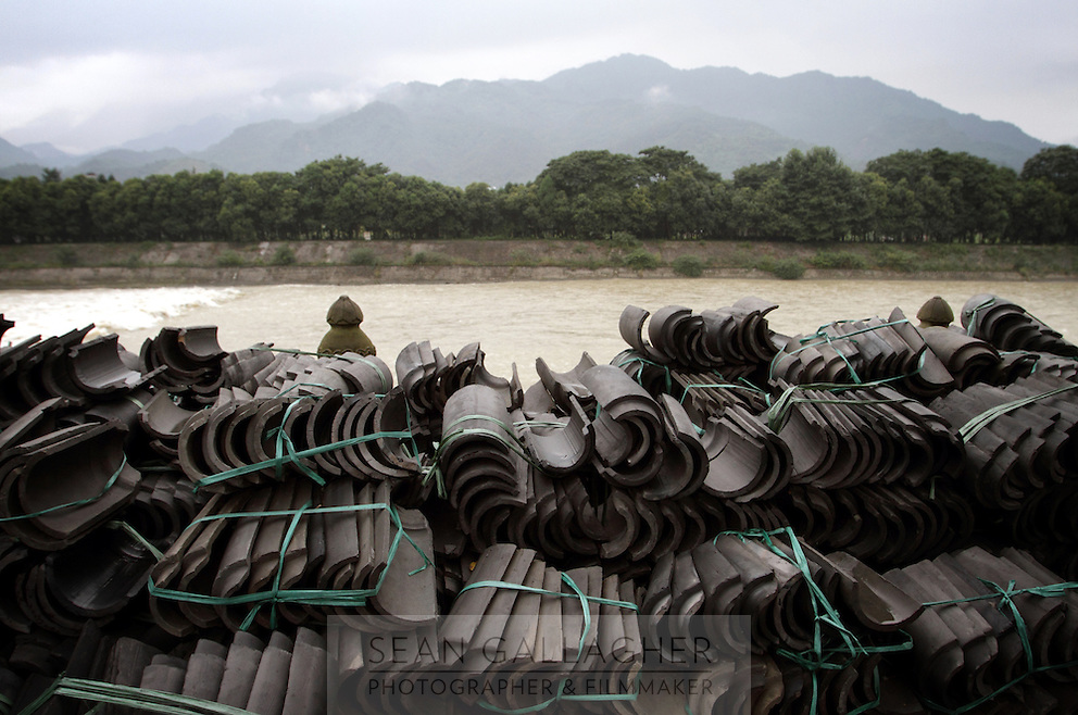"""One of the main channels that makes up the Dujiangyan Irrigation System. The system is regarded as an """"ancient Chinese engineering marvel."""" By naturally channeling water from the Min River during times of flood, the irrigation system served to protect the local area from flooding and provide water to the Chengdu basin. Sichuan Province. 2010"""