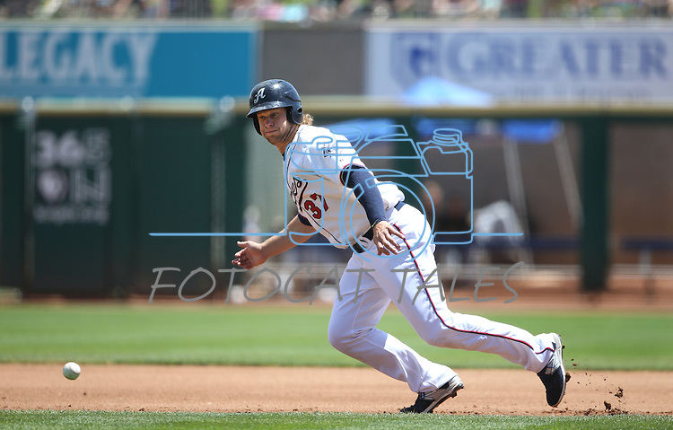 Reno Aces' Kyle Jensen watches a hit go past as he runs the bases against the Salt Lake Bees at Greater Nevada Field in Reno, Nev., on Tuesday, June 7, 2016. <br />